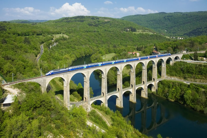 World Photography Day celebrates Wikimedia Commons Pictures of the Year 2011 Winners  -- # 5 – 46 votes in Final; A SNCF TGV Duplex trainset is crossing the Cize - Bolozon viaduct over the Ain river. The viaduct is part of the Haut-Bugey line, which was reopened in December 2010 for TGV services between Geneva and Paris