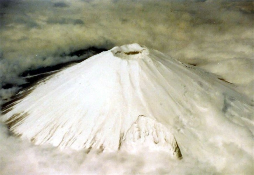 Aerial view of snow-capped crater located on the highest peak of Mt.Fuji