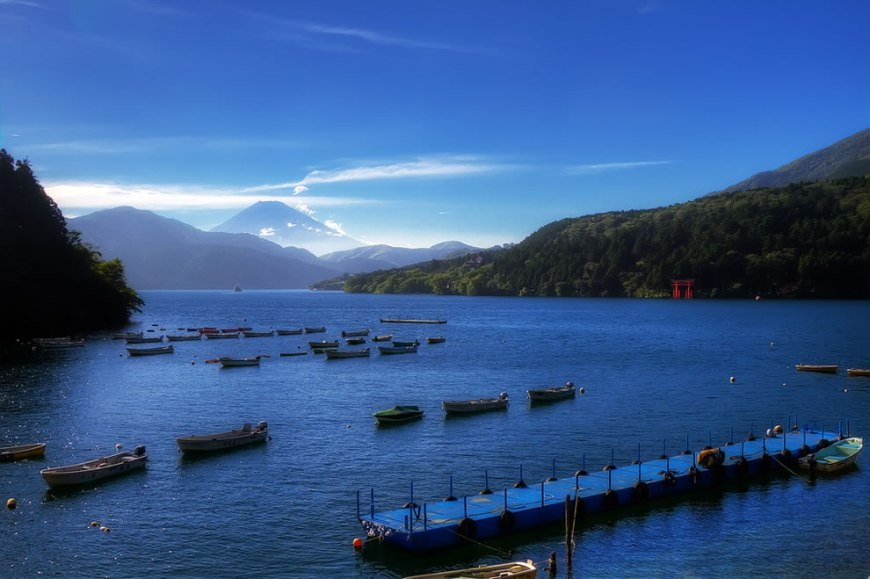 Lake Ashi near Motohakone-ko. Mt. Fuji-san can barely be seen from the back as well as the water gate (The Red Torii Gate)