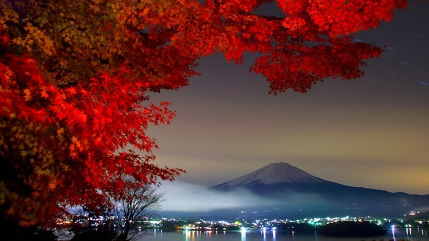Night view of Mt. Fuji with red autumn leaves from Kanagawa, Japan